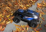LaTrax Teton 1/18 Scale 4WD Monster Truck up the curb